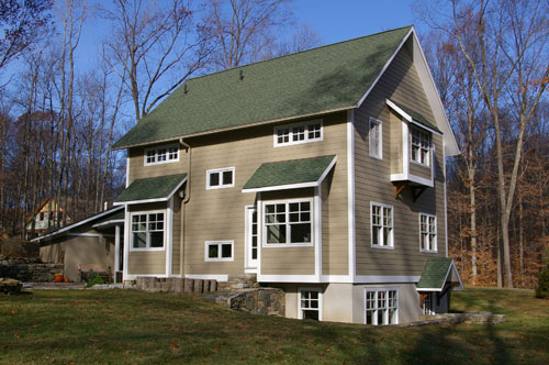 the siding is cement fiber, and the trim is engineered wood.