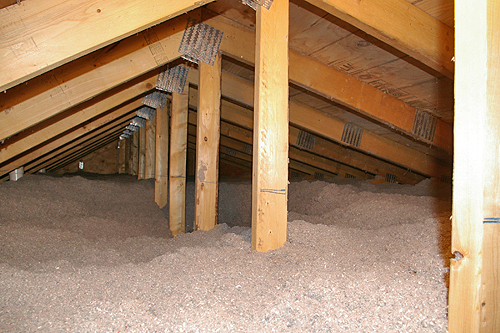 "Cellulose insulation covers the attic floor to a depth of 24""."