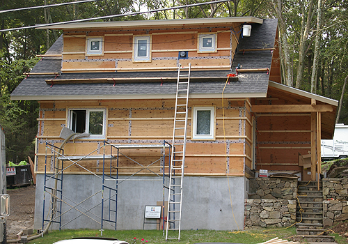 Exterior walls with taped sheathing joints