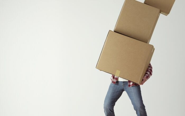 person with moving boxes