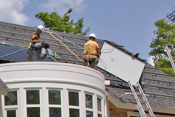 solar panels being installed on a green home in CT